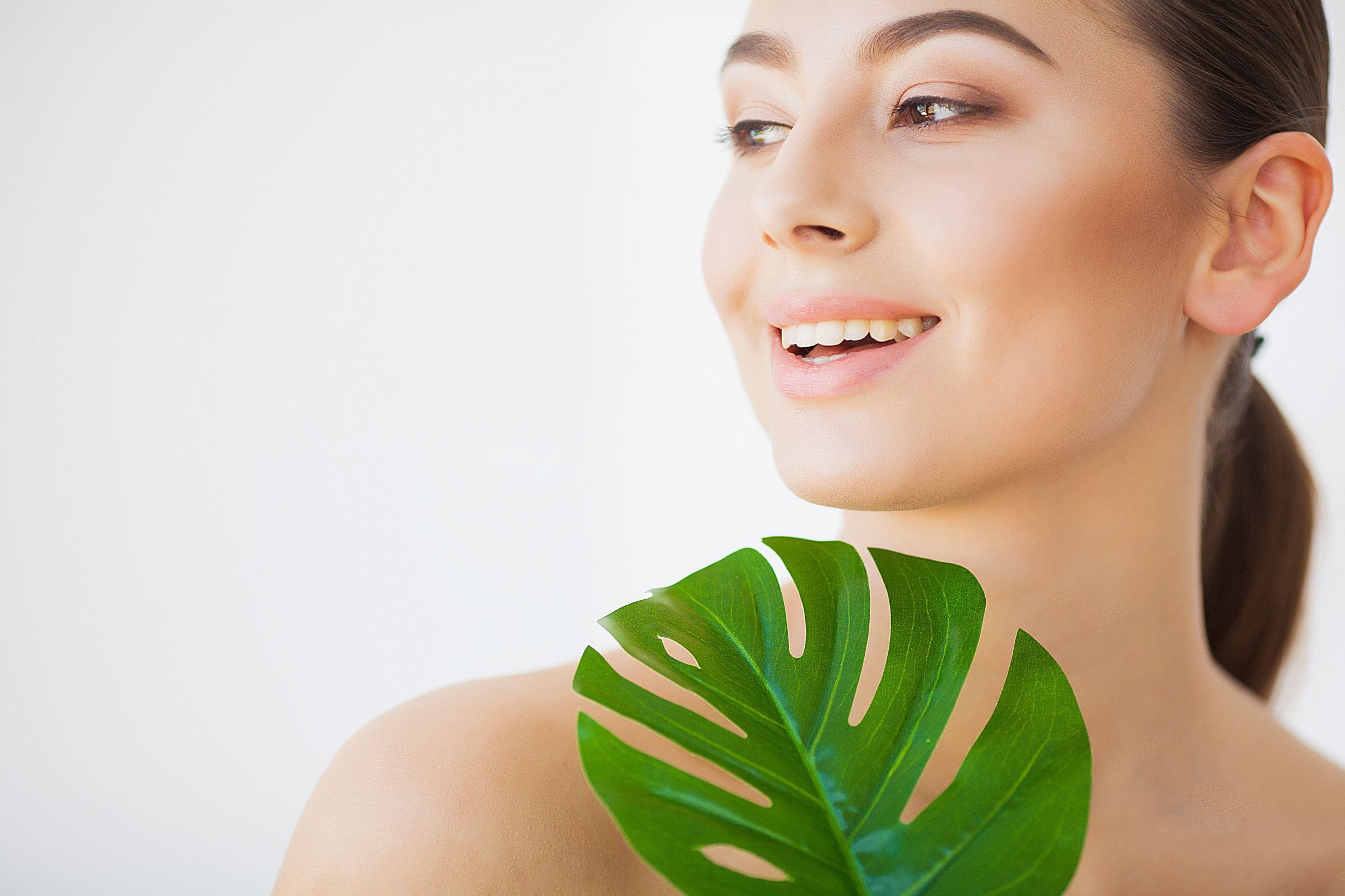 Spa Care Young Pretty Brunette Woman With Big Green Leaf